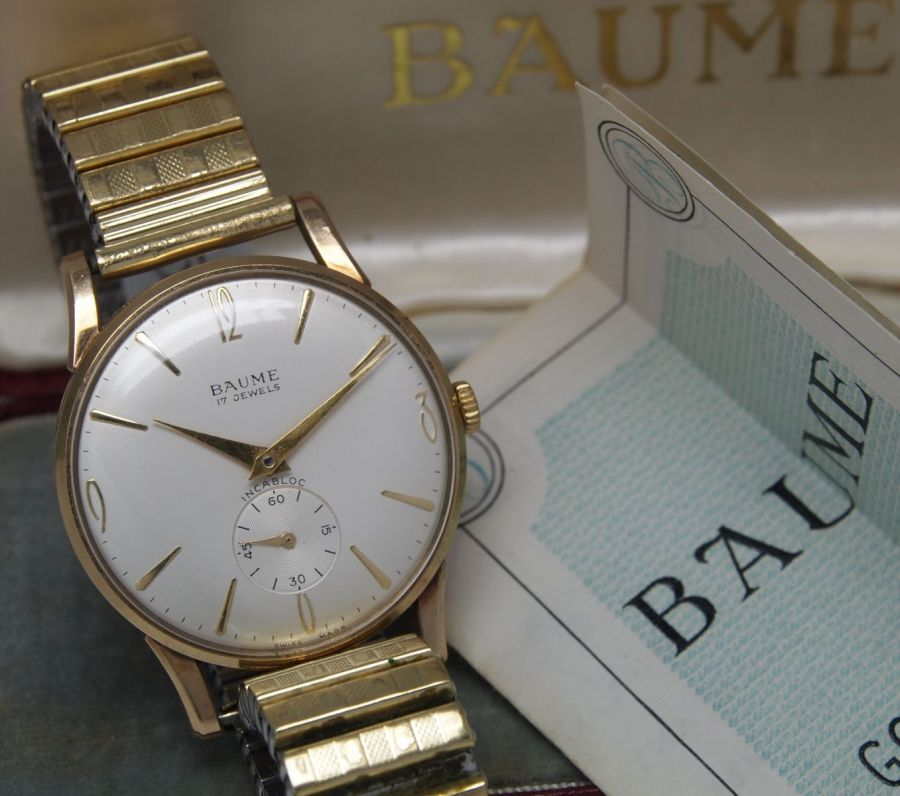 Baume 9ct gold watch.